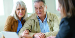 mature couple with financial representative