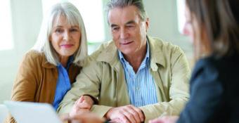mature couple with financial representative