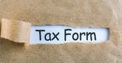 tax form with paper ripped