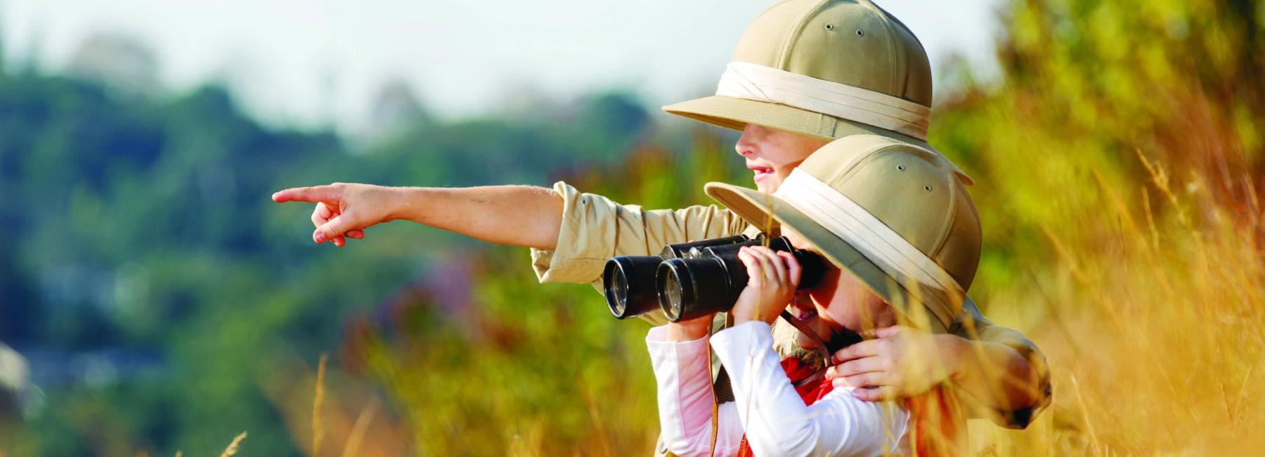children using binoculars