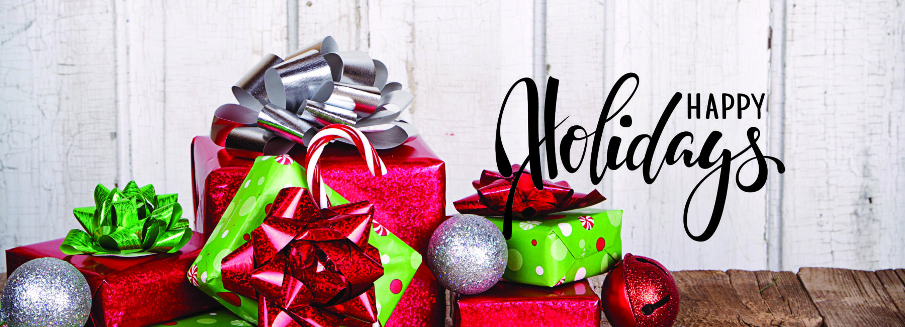 wrapped gifts with Happy Holidays text